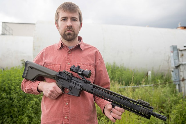 Seven Days political editor Paul Heintz on Monday with an AR-15 - JAMES BUCK