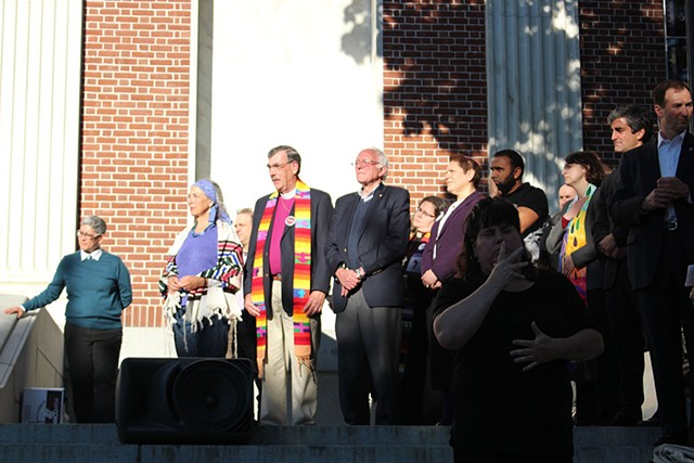 Sen. Bernie Sanders, center, at a vigil Monday at Burlington City Hall - PAUL HEINTZ