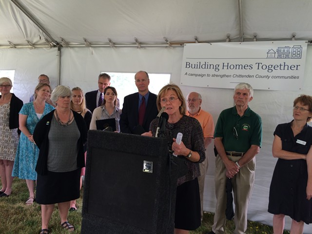 Brenda Torpy, chief executive officer of Champlain Housing Trust, answers questions from reporters at Monday's announcement. - ALICIA FREESE