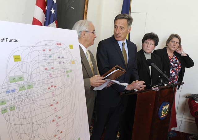 A poster charts a web of financial transactions related to the EB-5 projects. Also shown: Attorney General Bill Sorrell, Gov. Peter Shumlin, Department of Financial Regulation Commissioner Susan Donegan and Secretary of Commerce Pat Moulton. - JEB WALLACE-BRODEUR