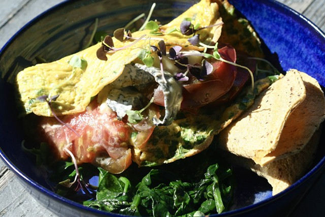 Tomato and cheese frittata over spinach with micro-basil and a corn tortilla - SUZANNE PODHAIZER