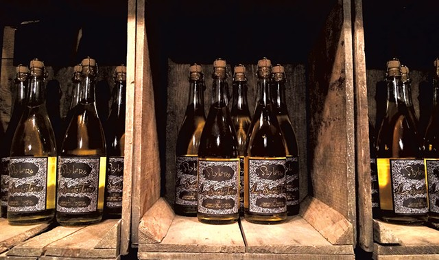 Bottles of La Sainte Terre at Slyboro Ciderhouse - JULIA CLANCY
