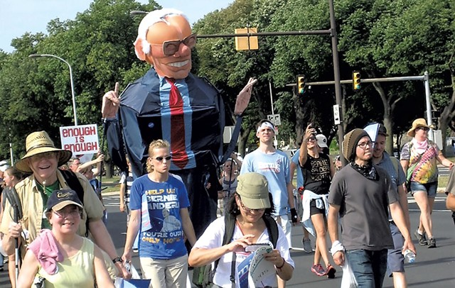 The man inside this 10-foot-tall Big Bernie creation: Los Angeles artist Alex Schaefer - KEVIN J. KELLEY