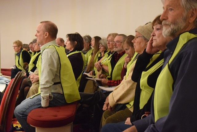 Opponents of wind projects wearing distinctive identifying vests at the last legislative session at the Statehouse. - TERRI HALLENBECK