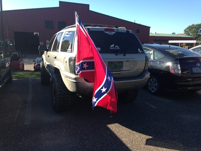The Confederate flag flying from an SUV in Burlington last year. - MOLLY WALSH