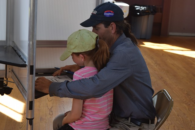 David Zuckerman, a Democratic candidate for lieutenant governor, votes with daughter Addie at the Hinesburg Town Hall on Tuesday afternoon. - TERRI HALLENBECK