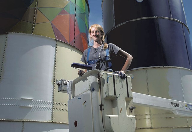 Mary Lacy painting silos at Dealer.com - FILE: MATTHEW THORSEN