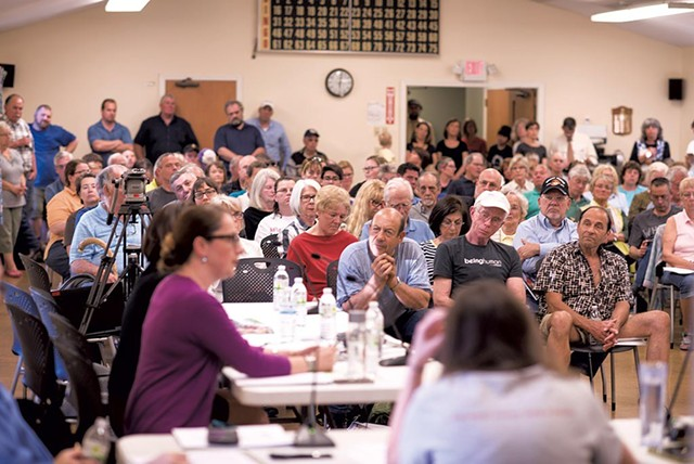 Rutland residents hear about refugee resettlement plans last May at a meeting of the Board of Aldermen. - CALEB KENNA