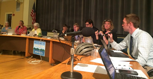Councilor Max Tracy, right, argues against increasing the allowable building height to 14 stories. - ALICIA FREESE