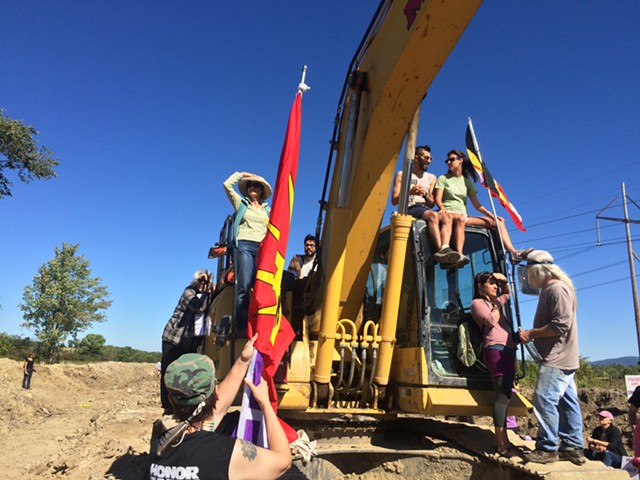 Protesters climbed onto equipment. - RACHEL JONES