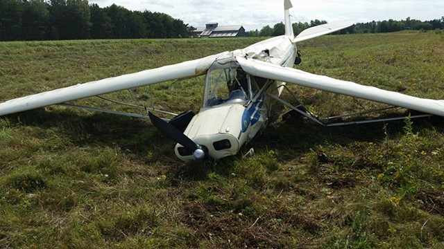 The crashed Piper PA-11 on the Savage Island runway - COURTESY