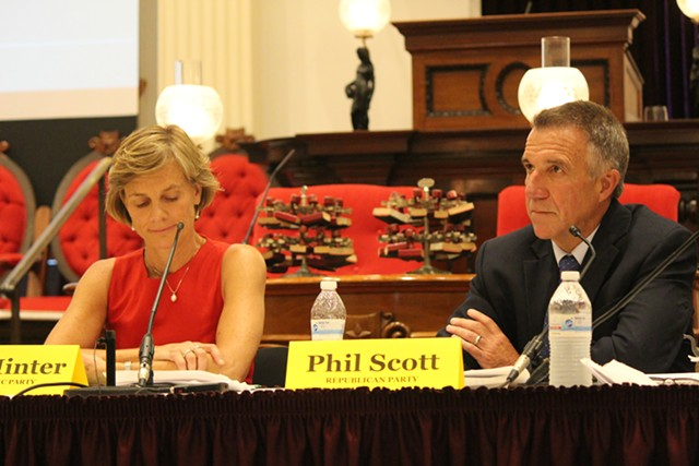 Sue Minter and Phil Scott at a gubernatorial forum Thursday at the Statehouse - PAUL HEINTZ