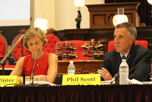 Sue Minter and Phil Scott at a gubernatorial forum Thursday at the Statehouse - PAUL HEINTZ