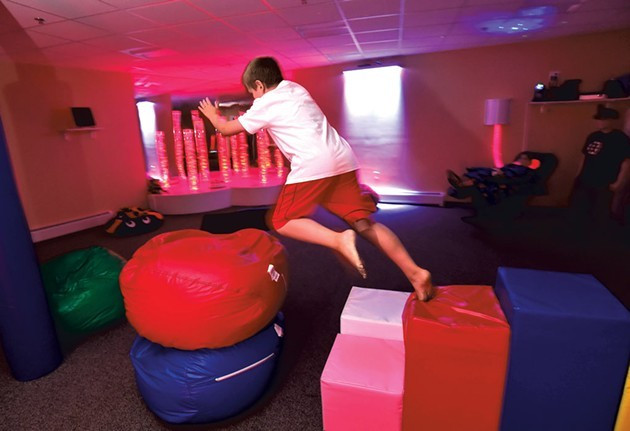 Beanbags and soft blocks in the Imagination Station - JEB WALLACE-BRODEUR