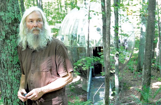 Russ Bennett in front of giant mirror ball from Super Ball IX - JEB WALLACE-BRODEUR