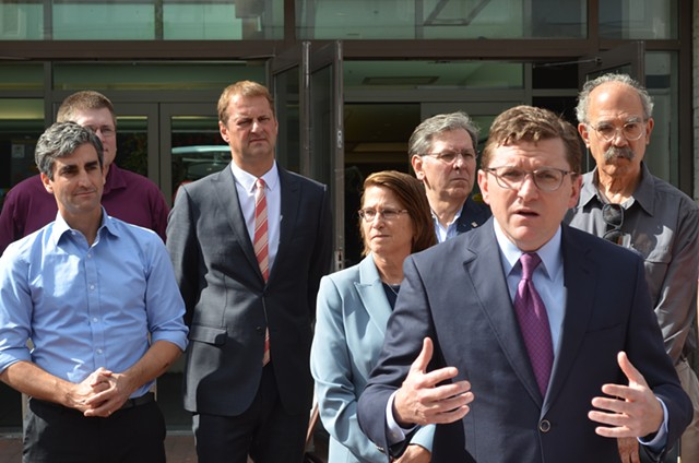 From left: Burlington Mayor Weinberger, John St.Hilaire of Vermont Gas, Corix chief operating officer and vice president Eric van Roon, Dawn LeBaron of UVM Medical Center, Don Sinex, BED director Neale Lunderville and Jan Schultz announce plans to pursue district heating on Wednesday. - ALICIA FREESE