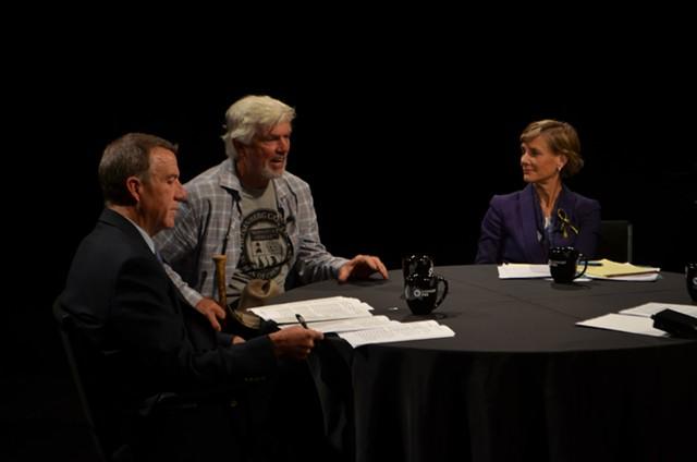 The candidates consider a question. - TERRI HALLENBECK