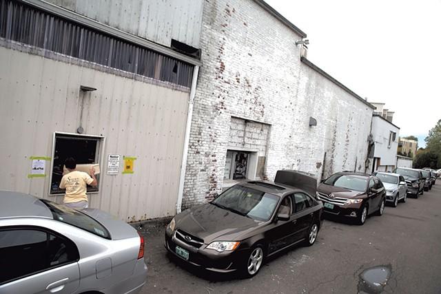 The line at the redemption center at Winooski's Beverage Warehouse - MATTHEW THORSEN