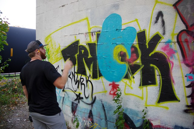 Travis Connolly adding details to his tag - STEPHEN MEASE