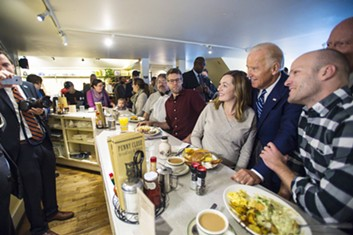 Vice President Joe Biden greets diners Friday morning at Penny Cluse Café in Burlington - POOL: GLENN RUSSELL/BURLINGTON FREE PRESS