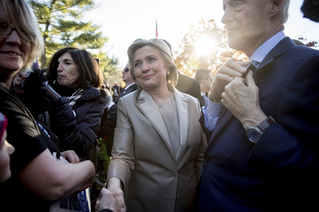 Hillary Clinton, accompanied by her husband, former President Bill Clinton, right, greeting supporters in Chappaqua, N.Y., after voting on Tuesday - AP PHOTO/ANDREW HARNIK