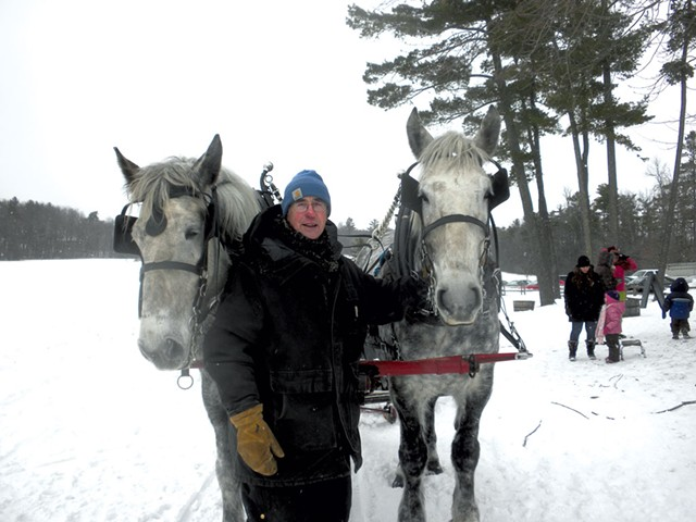 Pat Palmer with two of his Percherons - COURTESY OF MARSHALL WEBB/SHELBURNE FARMS