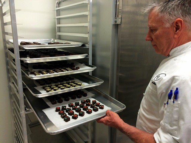 Kevin Toohey with a tray of truffles at Bijou Fine Chocolate - JULIA CLANCY