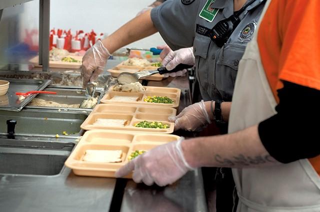 Preparing trays at Northeast Regional Correctional Facility - HANNAH PALMER EGAN
