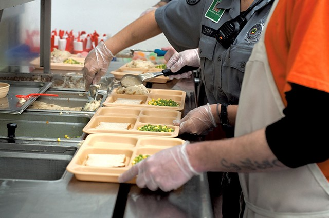 Preparing trays at Northeast Regional Correctional Facility - HANNAH PALMER EGAN