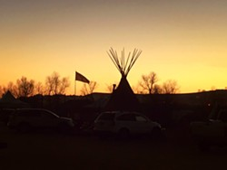 Dusk at Oceti Sakowin - AVI SALLOWAY