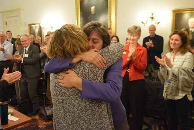 Reps. Mitzi Johnson, in purple, and Sarah Copeland Hanzas hug after Johnson won the vote to be the Democrats' nominee for House speaker. - TERRI HALLENBECK