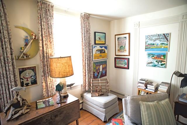 Bill Brooks' New Haven farmhouse is filled with folk art. - CALEB KENNA