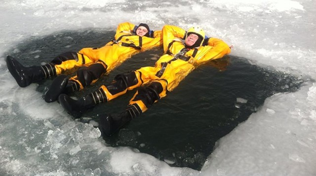 """Harty, right, soaking in a """"Vermont hot tub"""" as he taught an ice rescue class. - COURTESY OF TOM HARTY"""