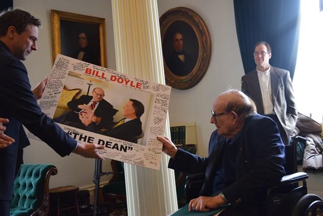 Senate President Pro Tempore Tim Ashe (D/P-Chittenden) presents former senator Bill Doyle with a signed photo Tuesday. - TERRI HALLENBECK