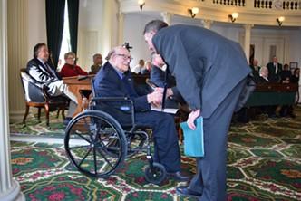 Gov. Phil Scott congratulates former senator Bill Doyle. - TERRI HALLENBECK