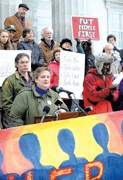 Mari Cordes of Rights & Democracy speaking at a rally last Wednesday outside the Statehouse - JEB WALLACE-BRODEUR