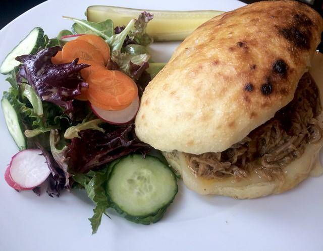 Pulled pork sandwich at One Radish - SUZANNE PODHAIZER