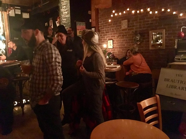 Attendees mingle at the Richard Brautigan Group Art Show at Radio Bean in Burlington. - SADIE WILLIAMS