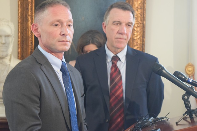 Commerce Secretary Michael Schirling (left) and Gov. Phil Scott talk Tuesday about the proposed agency reorganization. - TERRI HALLENBECK