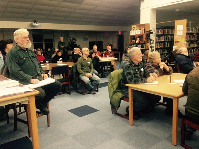 Jericho residents attend a workshop about land use rules Tuesday night at Mount Mansfield Union High School. - MOLLY WALSH/SEVEN DAYS