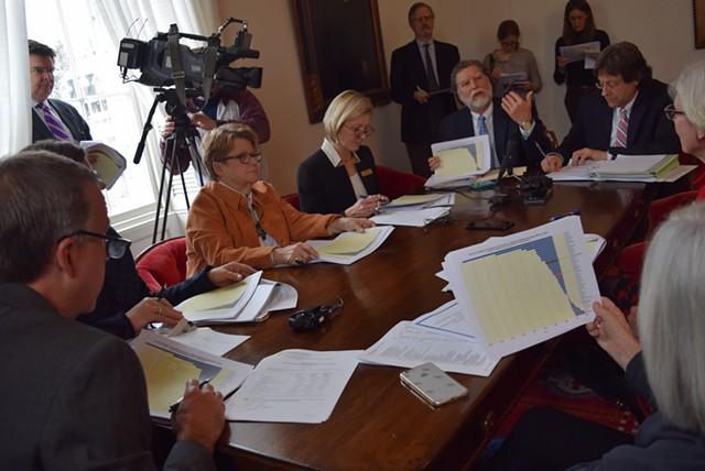 Gov. Phil Scott and the legislative money committee chairs listen to economists Tom Kavet and Jeff Carr on Thursday. - TERRI HALLENBECK