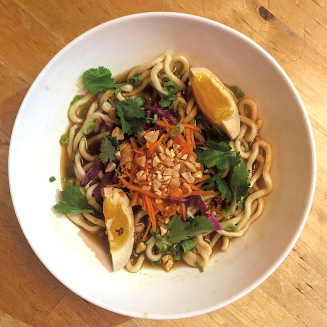 Handmade noodles with pickled duck egg and peanuts at Misery Loves Co.