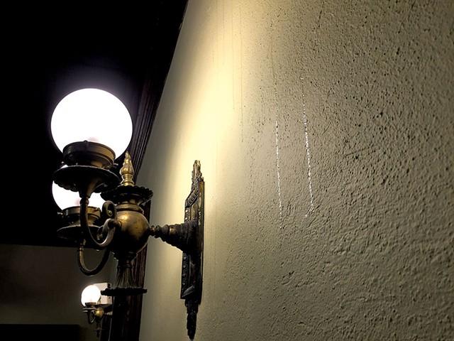 Honey dripping down the church wall - MEGAN JAMES