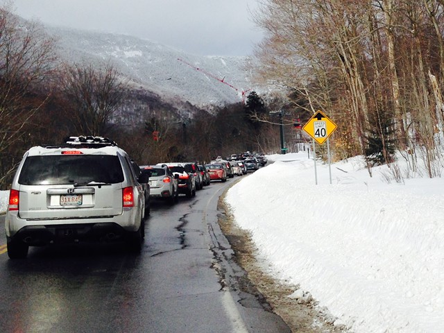 Cars sit on Vermont 108 waiting to get into a parking lot at Stowe  Mountain Resort on January 28. - MOLLY WALSH