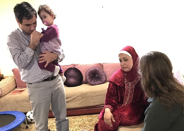 Fadwa Alaoui, in red, with her husband, Hamid Adlaoui, in their home in Brossard - COURTESY OF ANDY SOLOMON