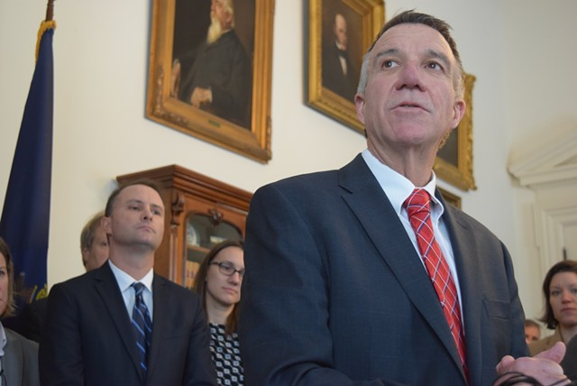 Gov. Phil Scott speaks last week about a bill to defy President Donald Trump's immigration order as Attorney General T.J. Donovan and others listen. - TERRI HALLENBECK