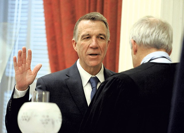 Phil Scott taking the oath of office in January - FILE: JEB WALLACE-BRODEUR