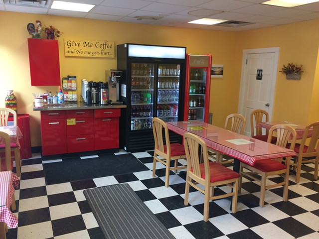 The dining room at the Little Red Kitchen - SUZANNE PODHAIZER