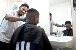 Noor Bulle giving Dadir Ali a haircut - JAMES BUCK
