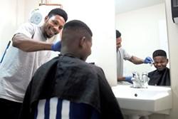 Noor Bulle giving Dadir Ali a haircut - JAMES BUCK